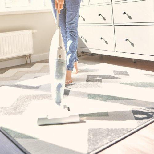Girl vacuuming floor