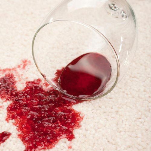 Wine spilled on a white floor